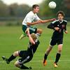 10-1-12 <br /> Boys Sectional Soccer<br /> Eastern HS vs Eastbrook HS<br /> Benjamin Bellow jumping over Eastbrook's Lucas Coyle while heading toward a shot.<br /> KT photo | Tim Bath