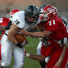 10-12-12<br /> Cass vs Western football<br /> Lucas Knutson of Cass tries to tackle Hudson Featherstone of Western during the football game Friday night.<br /> KT photo | Kelly Lafferty