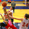 10-22-12<br /> KHS Girls Basketball practice<br /> Jasmine Love boxes out Haleigh Parrish as Cierra Tinder rebounds and Bri Poe reaches in during a rebounding drill with coach Jay Karp.<br /> KT photo | Tim Bath