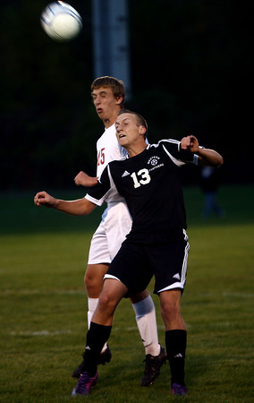 10-3-12<br /> Western vs. Logansport soccer<br /> Logansport's Phillip Stephenson and Western's Nic Bewley headbutt the ball during Wednesday's soccer game in which Logansport won 2-1.<br /> KT photo | Kelly Lafferty