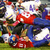 10-5-12 <br /> Kokomo HS vs Marion HS Football<br /> Kokomo's Anthony Clayton diving over players to tackle Marion's Javaris Riley in the 1st quarter.<br /> KT photo   Tim Bath