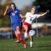 10-4-12<br /> Kokomo HS vs Logansport soccer<br /> Kokomo's Taylor Coram tries to kick the ball away from Logansport's Ashley Spear during Thursday's soccer game.<br /> KT photo | Kelly Lafferty
