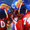 10-5-12 <br /> Kokomo HS vs Marion HS Football<br /> Jordan Rawlins and DaShawn Young trying to fire each other up between first and second quarter.<br /> KT photo   Tim Bath