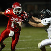 10-12-12<br /> Cass vs Western football<br /> Ben Lenahan of Western tries to pull down Drew Shepherd of Cass during Friday night's football game.<br /> KT photo | Kelly Lafferty