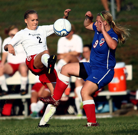 10-4-12<br /> Kokomo HS vs Logansport soccer<br /> Logansport's Morgan Brew and Kokomo's Kendra Ryker both kick at the ball during the soccer game Thursday.<br /> KT photo | Kelly Lafferty