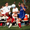 10-4-12<br /> Kokomo HS vs Logansport soccer<br /> Logansport's Morgan Brew and Kokomo's Kendra Ryker both kick at the ball during the soccer game Thursday.<br /> KT photo | Kelly Lafferty