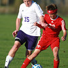 10-9-13<br /> Northwestern vs. Rossville soccer<br /> Northwestern's Jacob Wagner and Rossville's Griffey Saylor.<br /> KT photo | Kelly Lafferty