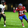 10-4-13<br /> Kokomo vs. Logansport football<br /> Kokomo's Jordan Rawlins eyes Logansport's Austin Gaby.<br /> KT photo | Kelly Lafferty