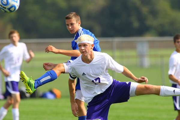 10-12-13  --- Sectional Boys Soccer - NWHS vs Tipton HS -- Tipton's Luke Tragesser and NW's Graham Ortmann going after a high kick.<br />   KT photo | Tim Bath