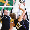 10-22-13<br /> Northwestern vs. Western volleyball sectional<br /> Western's Bretta Tate and Bailey Cook try to block a shot from Northwestern's Hannah Ballard.<br /> KT photo | Kelly Lafferty