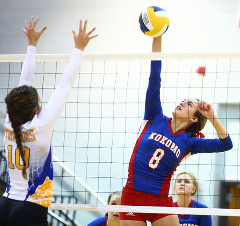 10-1-13<br /> Kokomo vs. Tri Central volleyball<br /> Kokomo's Kirsten Frey hits one over to Tri Central as Hadley DeWeese tries to block it.<br /> KT photo | Kelly Lafferty