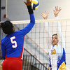 10-1-13<br /> Kokomo vs. Tri Central volleyball<br /> Tri Central's Hadley DeWeese tries to block Kokomo's Alanis Jones hit.<br /> KT photo | Kelly Lafferty