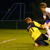 10-17-13  --  Regional Boys Soccer Northwestern vs Western Boone HS<br /> Robert Olsen shoots with a deflection from goalee Andrew Kneckt but Kneckt deflects the ball back to Olsen who shoots and scores.<br />   KT photo | Tim Bath