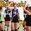 10-22-13<br /> Northwestern vs. Western volleyball sectional<br /> Northwestern's Hannah Ballard (center) celebrates with her teammates after Northwestern scores.<br /> KT photo | Kelly Lafferty
