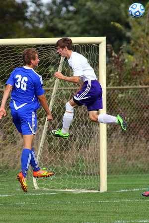 10-12-13  --- Sectional Boys Soccer - NWHS vs Tipton HS  -- Tipton's Sondre Stangeland trying to defend against NW's Robert Olsen heading the ball on a corner kick. Despite missing this goal NW won 9-0.<br />   KT photo | Tim Bath