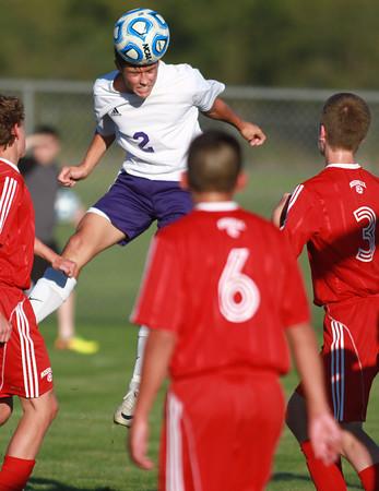 10-9-13<br /> Northwestern vs. Rossville soccer<br /> Northwestern's Blaine Brutus headbutts the ball.<br /> KT photo | Kelly Lafferty