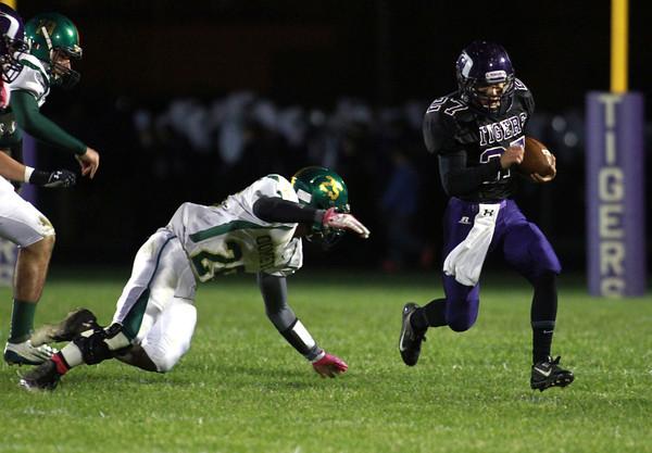 10-18-13<br /> Northwestern vs. Eastern football<br /> Northwestern's Tanner Wildrick escapes Eastern's Papee Byers.<br /> KT photo | Kelly Lafferty