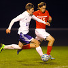 10-17-13  --  Regional Boys Soccer Northwestern vs Western Boone HS<br /> Robert Olsen shooting yet another goal with W. Boone's Jared Michalke trying to stop him.<br />   KT photo | Tim Bath