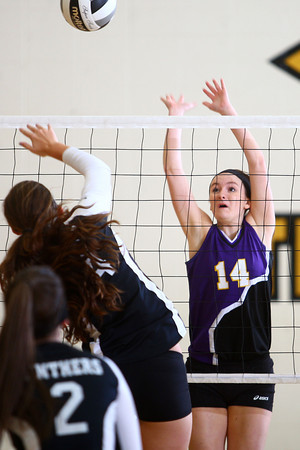 10-22-13<br /> Northwestern vs. Western volleyball sectional<br /> Northwestern's Alexis Brown jumps up to try and block a shot from Western.<br /> KT photo   Kelly Lafferty