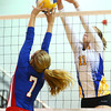 10-1-13<br /> Kokomo vs. Tri Central volleyball<br /> Kokomo's Miranda Ogle and Tri Central's Shelby Ramsey go up against each other at the net.<br /> KT photo | Kelly Lafferty