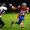 10-4-13<br /> Kokomo vs. Logansport football<br /> Kokomo's Jordan Rawlins tries to out run Logansport's Caleb McLochlin.<br /> KT photo | Kelly Lafferty
