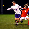 10-17-13  --  Regional Boys Soccer Northwestern vs Western Boone HS<br /> Northwestern's Jacob Wagner and WB's Alex Glidewell getting tangled up while going after the ball.<br />   KT photo | Tim Bath