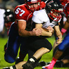 10-4-13<br /> Kokomo vs. Logansport football<br /> Kokomo's Fletcher Miller takes down Logansport's Ryan Schrock.<br /> KT photo | Kelly Lafferty