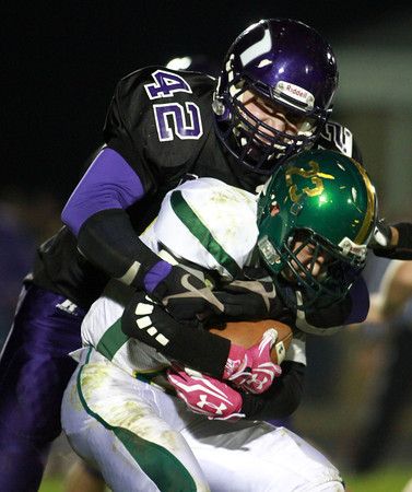 10-18-13<br /> Northwestern vs. Eastern football<br /> Northwestern's Billy Parslow tackles Eastern's Noah Aaron.<br /> KT photo | Kelly Lafferty
