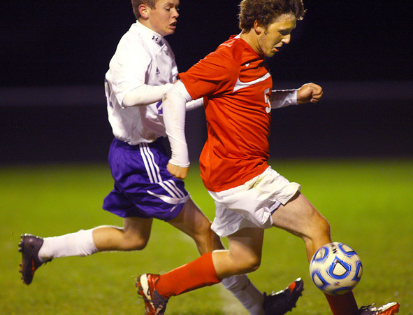 10-17-13  --  Regional Boys Soccer Northwestern vs Western Boone HS<br /> Northwestern's Cameron Cothern loosing the ball to Western Boone's Alex Glidewell stopping the attack.<br />   KT photo | Tim Bath