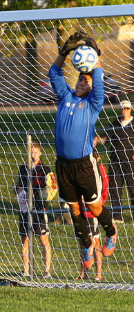 10-7-13  --- Sectional Boys Soccer - WHS vs KHS  - Westerns goalkeep Edgar Sanchez stopping a shot by KHS.<br />   KT photo | Tim Bath