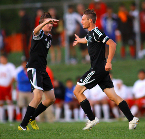 10-7-13  --- Sectional Boys Soccer - WHS vs KHS  - Westerns Braden Crowell shakes hands with Chris Root after root scored the only goal.<br />   KT photo | Tim Bath