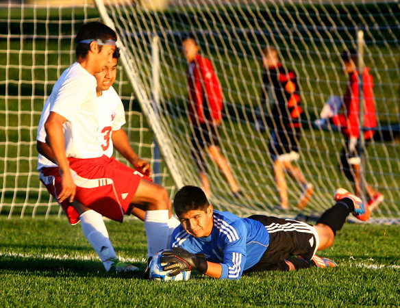 10-7-13  --- Sectional Boys Soccer - WHS vs KHS  - Westerns goalkeep Edger Sanchez stopping a shot by KHS with a deflect then jumping on it before the followup.<br />   KT photo | Tim Bath