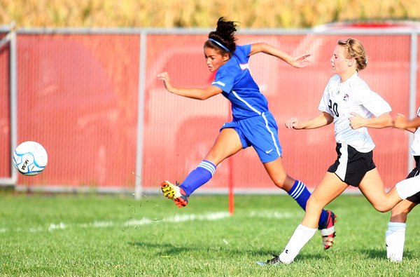 10-2-13<br /> Kokomo vs. Western girls soccer<br /> Cheyenne Eltringham makes a shot for the goal before Western's Autumn Brady can stop her.<br /> KT photo | Kelly Lafferty