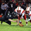10-25-13<br /> Western vs. Mississinewa football<br /> Western's Drew Bellus recovers a fumble by Mississinewa.<br /> KT photo | Kelly Lafferty