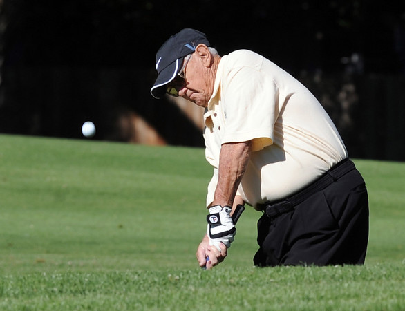 Jim McCarley hits at hole 9.<br /> Cliff Grassmick / July 18, 2012