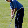 Walt Lessig chips at hole 9. He was tied for the lead with Howard Machlan.<br /> Cliff Grassmick / July 18, 2012