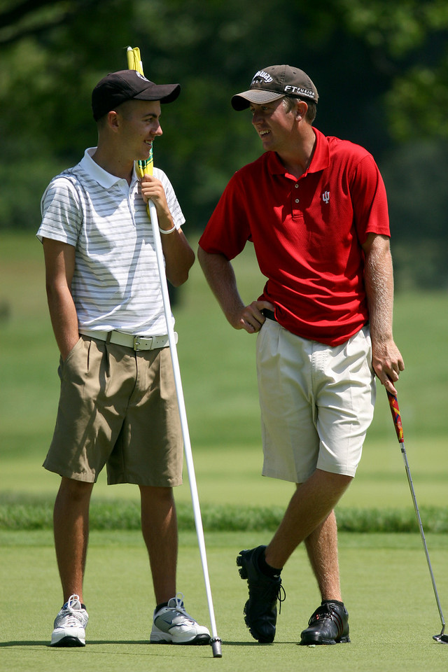 E.L. Hubbard Photography<br /> Alex Martin, right, from Middletown, chats with his caddie, his brother, Charlie Martin, on the 18th green during the Ohio Amateur at Moraine Country Club Friday, July 17, 2009.