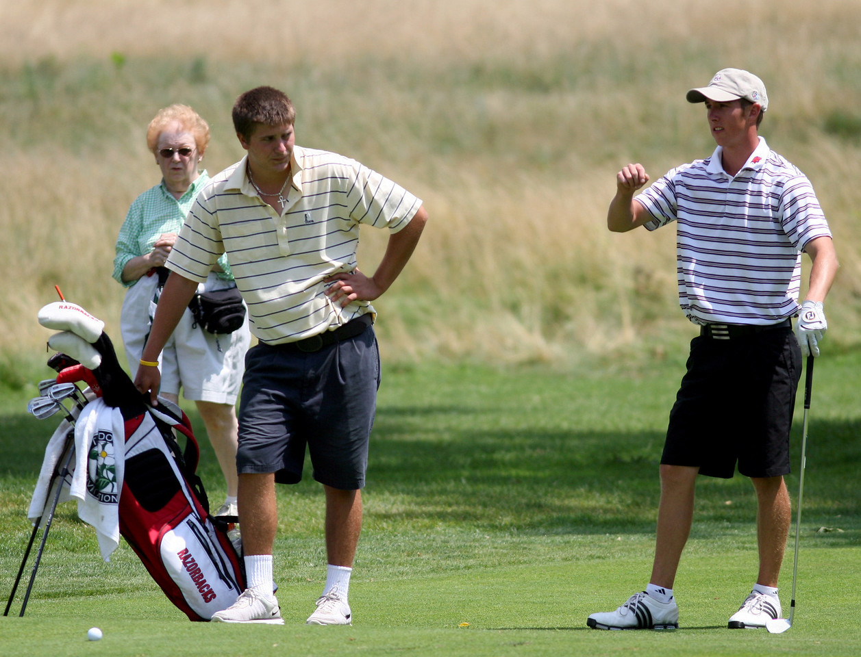 E.L. Hubbard Photography<br /> Ethan Tracy, right, from Hilliard, with his caddie, David Haley,  during the Ohio Amateur at Moraine Country Club Friday, July 17, 2009.