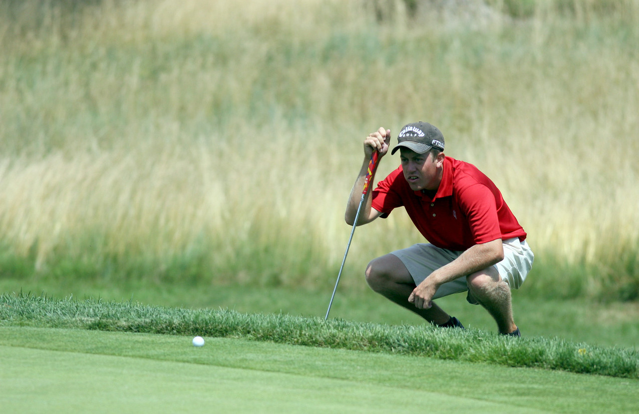 E.L. Hubbard Photography<br /> Alex Martin, from Middletown, eyes his putt from the edge of the 18th green during the Ohio Amateur at Moraine Country Club Friday, July 17, 2009.