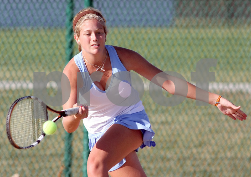 Summit Country Day's Gabby Steele hits a return during her match in the girls district championships at Centerville High School in Centerville Saturday, October 11, 2008. Steele won the district title, and is the defending state champion.