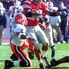 Jonathon Wells runs over Bobby Jackson.<br /> Photo ben French