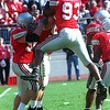(Left) Tim Anderson celebrates with fellow Buckeye defenders.<br /> Photo Ben French