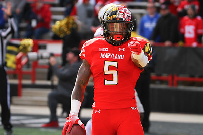 Maryland RB #5 Anthony McFarland points at the memorial to #79 Jordan McNair after scoring a touchdown.