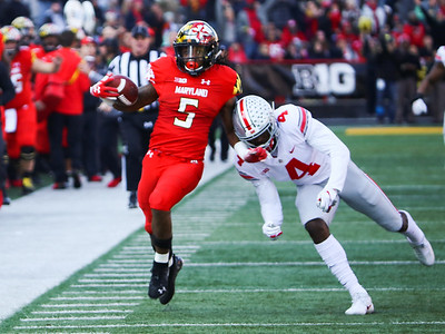 Ohio State S #4 Jordan Fuller pushes Maryland RB #5 Anthony McFarland out of bounds