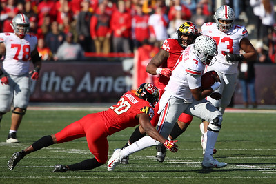 Ohio State QB #7 Dwayne Haskins Jr. breaks a tackle by Maryland DB #20 Antwaine Richardson
