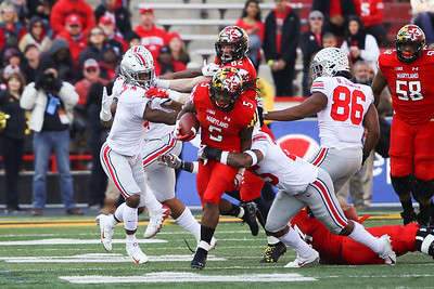 Maryland RB #5 Anthony McFarland breaks a tackle by Ohio State