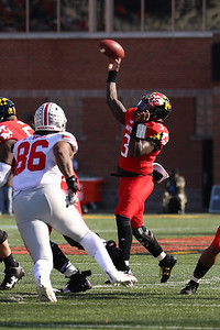 Maryland QB #3 Tyrell Pigrome drops back and passes the ball.