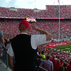 Stadium employee pauses to the National Anthem.