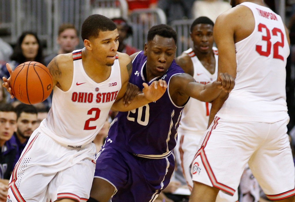 . Ohio State\'s Trevor Thompson, right, sets a pick for teammate Marc Loving, left, as Northwestern\'s Scottie Lindsey defends during the first half of an NCAA college basketball game Sunday, Jan. 22, 2017, in Columbus, Ohio. (AP Photo/Jay LaPrete)