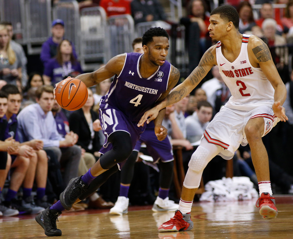 . Northwestern\'s Vic Law, left, drives around Ohio State\'s Marc Loving during the second half of an NCAA college basketball game Sunday, Jan. 22, 2017, in Columbus, Ohio. (AP Photo/Jay LaPrete)